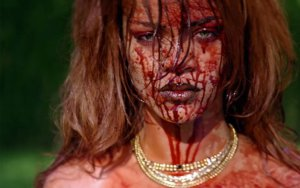 Still from Rhianna's music video about torturing a white woman for money
