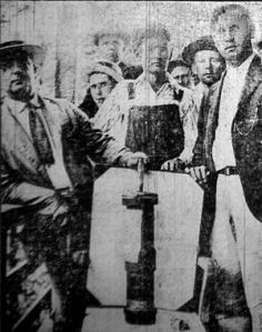 Coal miners displaying a bomb that was dropped during the Battle of Blair Mountain in 1921